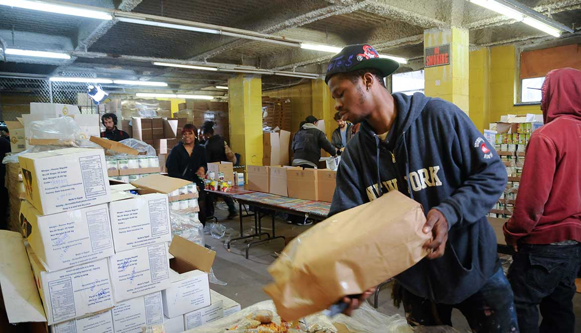 People at work at a food bank warehouse.